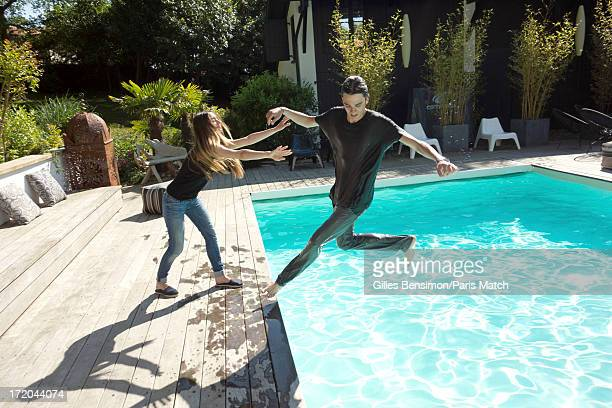 Actor AlainFabien Delon is photographed with his fiancee Lea Lunghini for Paris Match on June 11 2013 in Biarritz France