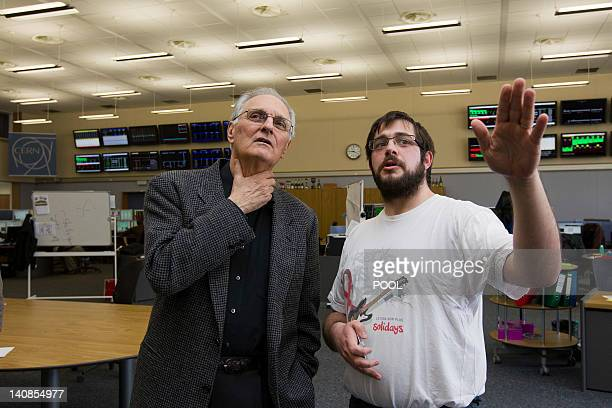 US actor Alan Alda visits with Herve Genoud Operator of control the CERN Control Centre where the operators prepare the commissioning of the LHC at...