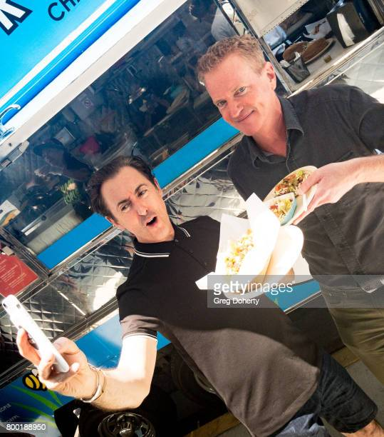 Actor Alan Cumming and PETA Senior Vice President of Campaigns Dan Mathews eat vegan tacos after hosting a news confernece exposing the fate of...