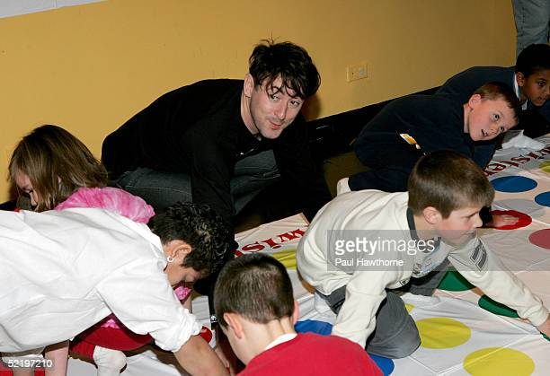 Actor Alan Cumming plays Twister as he takes part in a 'Son of the Mask' event at The Children's Museum of Manhattan on February 14 2005 in New York...