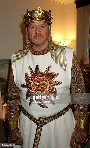 Actor Alan Dale poses backstage following his first night as King Arthur in Spamalot at the Palace Theatre March 11 2008 in London England