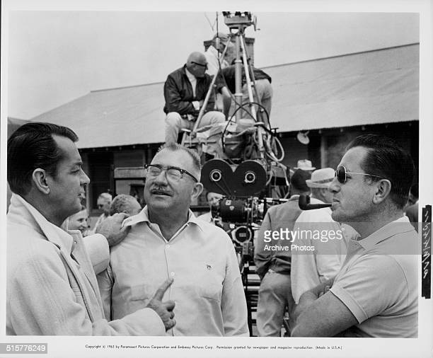 Actor Alan Ladd and director Edward Dmytryk on the set of the movie 'The Carpetbaggers', circa 1964.