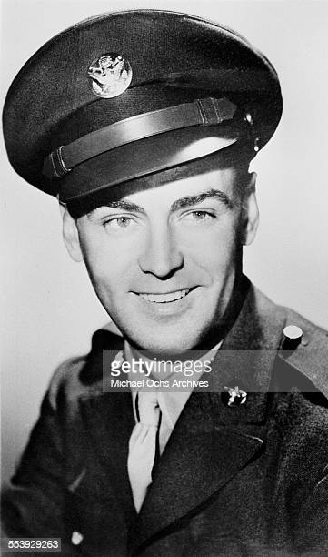 Actor Alan Ladd poses in his uniform for the 18th Army Air Forces Base Unit in Los Angeles, California.