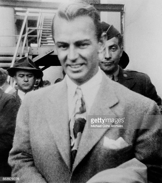 Actor Alan Ladd poses on a street in Los Angeles, California.
