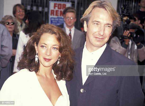 Actor Alan Rickman and date attending the premiere of 'Robin Hood Prince of Thieves' on June 10 1991 at Mann Village Theater in Westwood California