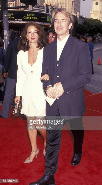 Actor Alan Rickman and date attending the premiere of 'Robin HoodPrince of Thieves' on June 10 1991 at Mann Village Theater in Westwood California