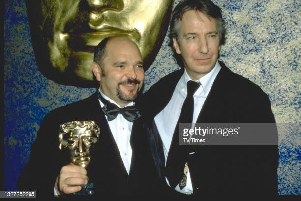 Actor Alan Rickman and director Anthony Minghella photographed at the BAFTA Film and Television Awards at the Royal Albert Hall in London on April...