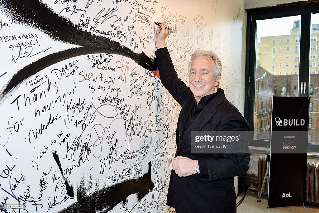 Actor Alan Rickman signs the wall at the AOL Build Speaker Series at AOL Studios In New York on June 19, 2015 in New York City.