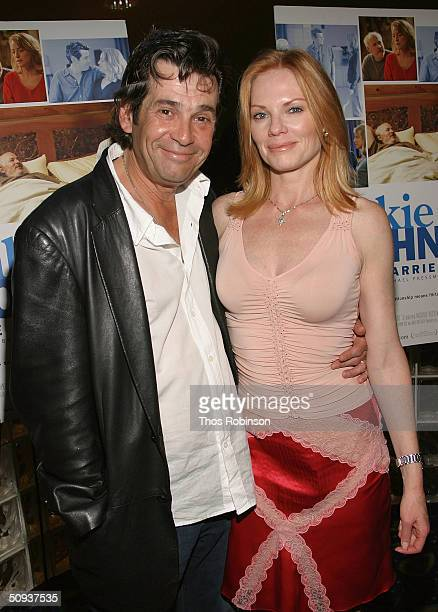 Actor Alan Rosenberg and his wife Actress Marg Helgenberger attend the Premiere of Frankie and Johnny Are Married on June 7, 2004 at Clearview...