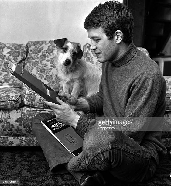 Actor Alan Rothwell one of the stars of the television soap opera Coronation Street at home with his pet dog 1967