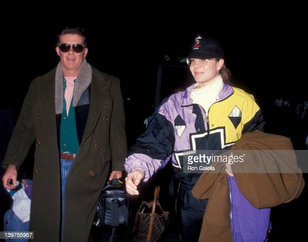 Actor Alan Thicke and date Gina Tolleson being photographed on January 17 1993 at the Los Angeles International Airport in Los Angeles California