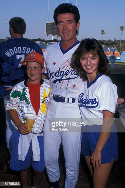 Actor Alan Thicke son Brennan Thicke and actress Caryn Richmond attending Hollywood AllStars Baseball Game on August 29 1987 at Dodger Stadium in Los...