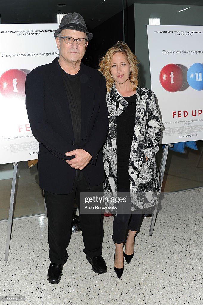 Actor Albert Brooks and a guest arrive at the Los Angeles premiere of 'Fed Up' at Pacfic Design Center on May 8, 2014 in West Hollywood, California.