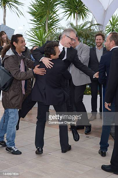 Actor Albert Dupontel picks up General Delegate of the Cannes Film Festival Thierry Fremaux at the 'Le Grand Soir' Photocall during the 65th Annual...
