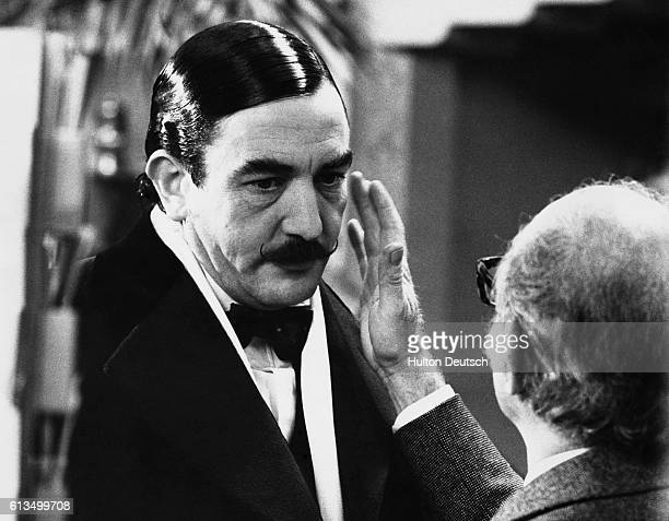 Actor Albert Finney being made up as Agatha Christie's famous Belgian detective Hercule Poirot on the set of the film Orient Express London 1974