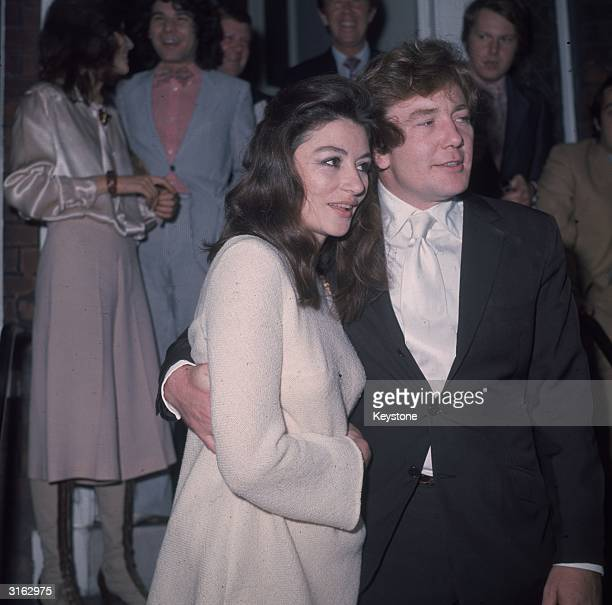 Actor Albert Finney with his arm round his bride, French film actress Anouk Aimee .