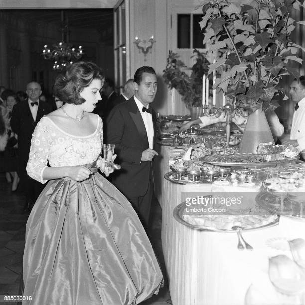 Actor Alberto Sordi and actress Silvana Mangano at the dinner party for the movie 'The Tempest' Italy 1958