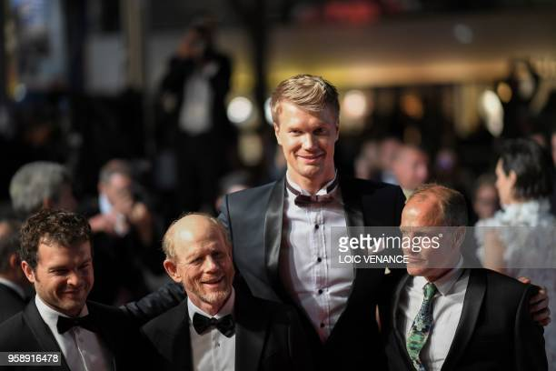 Actor Alden Ehrenreich, US director Ron Howard, Finnish actor Joonas Suotamo and US actor Woody Harrelson pose as they leave the Festival Palace on...
