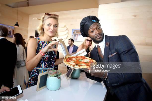 Actor Aldis Hodge hands out pizza at ATT's Jon Vinny's popup pizza bar at the 2017 Film Independent Spirit Awards sponsored by ATT at Santa Monica...