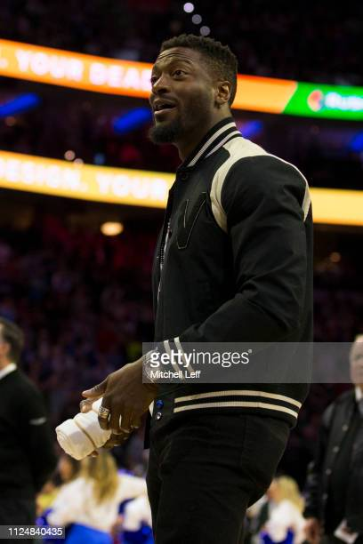 Actor Aldis Hodge throws tshirts to fans during a timeout in the game between the San Antonio Spurs and Philadelphia 76ers at the Wells Fargo Center...
