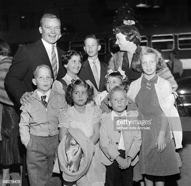 Actor Aldo Ray and his wife Jeff Donnell attend a premiere with kids in Los AngelesCA