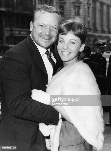 Actor Aldo Ray and his wife Johanna Bennett attending the premiere of his film 'The Day They Robbed the Bank of England' London May 18th 1960
