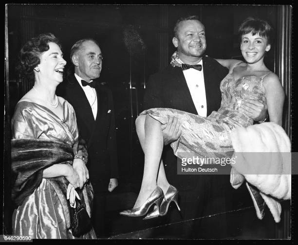 Actor Aldo Ray attends the premiere of his latest film The Day They Robbed the Bank of England with his wife Johanna and her parents Major General...