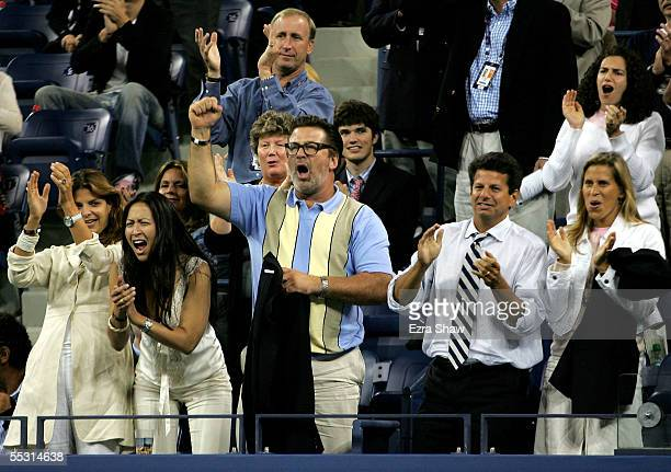 Actor Alec Baldwin and girlfriend Nicole Seidel cheer during the fifth set of the quarterfinal match between Andre Agassi and James Blake at the US...