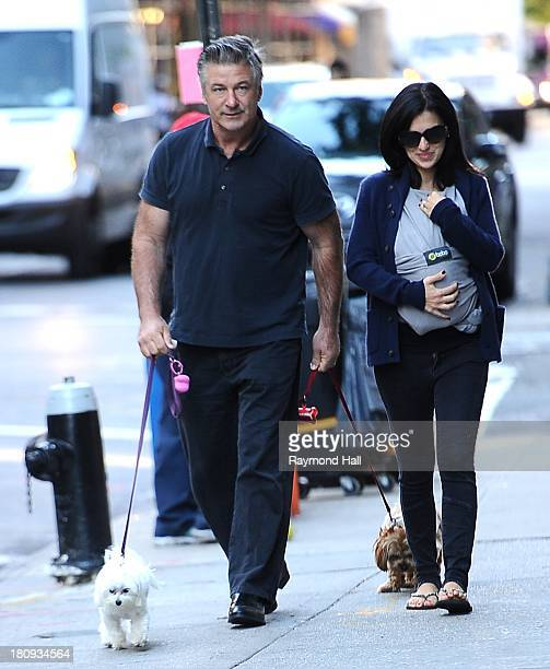 Actor Alec Baldwin and Hilaira Baldwin, who carries their daughter Carmen, are seen in Soho on September 17, 2013 in New York City