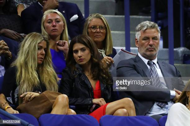 Actor Alec Baldwin and his wife Hilaria Baldwin watch Maria Sharapova of Russia during her first round Women's Singles match against Simona Halep of...