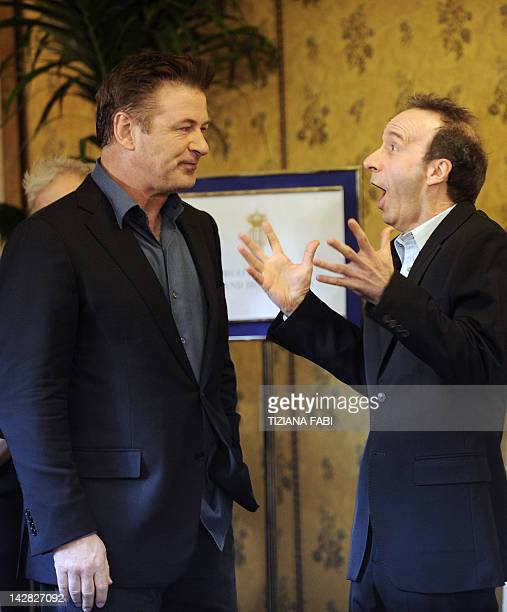 US actor Alec Baldwin and Italian actor Roberto Benigni pose during the potocall of 'To Rome With Love' on April 13 2012 at a hotel in Rome 'To Rome...