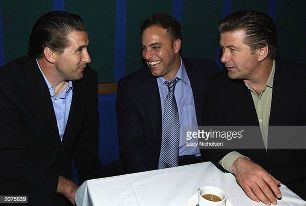 Actor Alec Baldwin chats to his brother Billy Baldwin and his agent as they attend the postpremiere party of The Cooler on June 11 2003 at the Sunset...