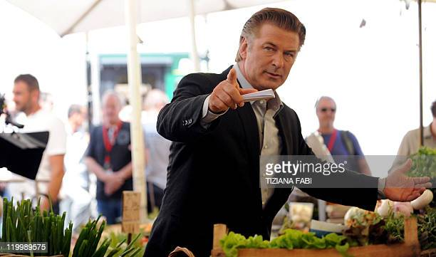 US actor Alec Baldwin gestures while on the set of US film director Woody Allen's latest production 'Bop Decameron' at Campo de' Fiori square in...