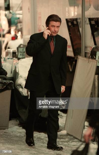 Actor Alec Baldwin performs on the movie set of Devil and Daniel Webster January 22 2001 outside Cerruti's Boutique on Madison Avenue in New York City