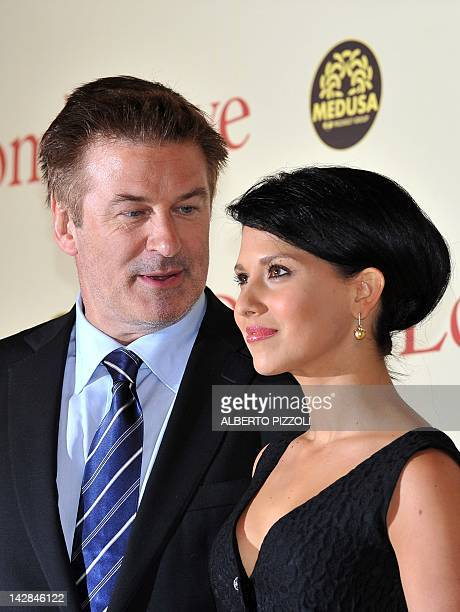 US actor Alec Baldwin poses with Ilaria Thomas as they arrives for the premiere of 'To Rome With Love' on April 13 2012 in Rome 'To Rome With Love'...