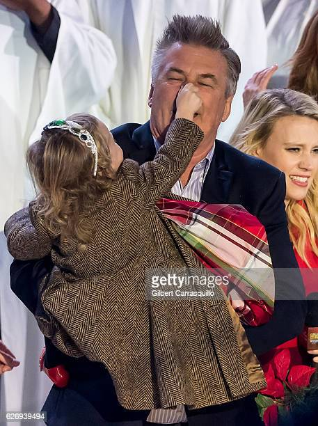 Actor Alec Baldwin with his daughter Carmen Gabriela Baldwin on stage during the 84th Rockefeller Center Christmas Tree Lighting at Rockefeller...