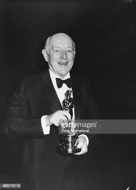 Actor Alec Guinness with his Honorary Oscar at the 52nd Academy Awards Los Angeles April 14th 1980