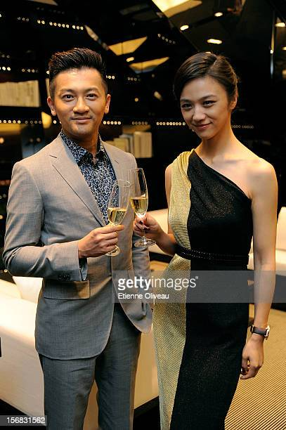 Actor Alec Su and actress Tang We pose for photographs during the IWC Flagship Boutique Opening on November 22 2012 in Beijing China