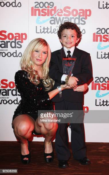 Actor Alex Bain poses with Brooke Kinsella as he holds the Best Young Actor Award at Inside Soap Awards held at Sketch on September 28 2009 in London...