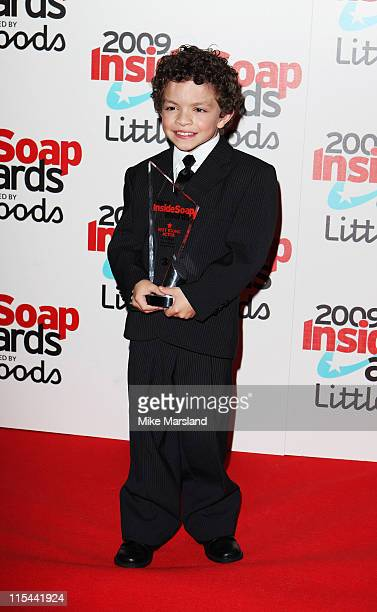 Actor Alex Bain poses with the Best Young Actor Award as he attends the Inside Soap Awards held at Sketch on September 28 2009 in London England