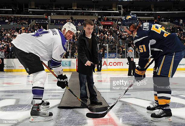 Actor Alex Etal drops the puck for Rob Blake Los Angeles Kings and Brian Campbell of the Buffalo Sabres before the game at Staples Center on December...