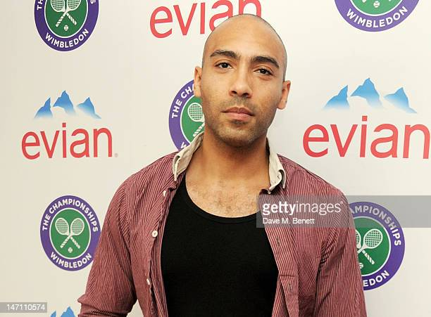 Actor Alex Lanipekun attends the evian 'Live young' VIP Suite at Wimbledon on June 25 2012 in London England