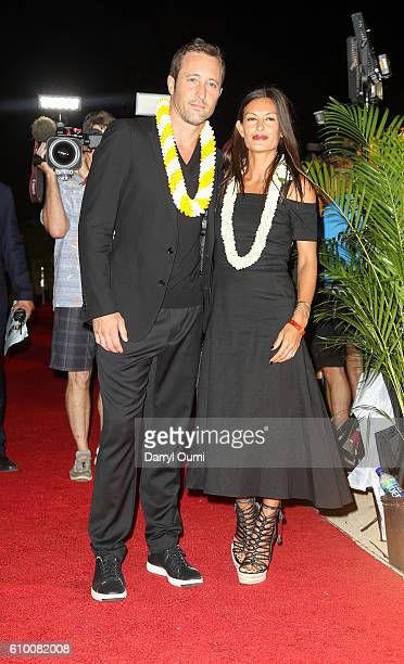 Actor Alex O'Loughin and his wife Malia Jones pose for a photo as they walk the red carpet at the CBS 'Hawaii Five0' Sunset On The Beach Season 7...