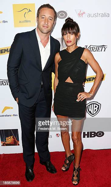 Actor Alex O'Loughlin and surfer Malia Jones attend the Australians in Film Benefit Dinner at the at Intercontinental Hotel on October 24 2013 in...