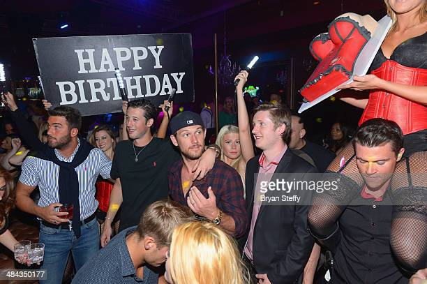 Actor Alex Pettyfer is presented a birthday cake as he celebrates his birthday at Beacher's Madhouse Las Vegas at the MGM Grand Hotel/Casino on April...