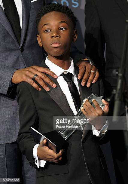 Actor Alex R Hibbert poses in the press room during The 22nd Annual Critics' Choice Awards at Barker Hangar on December 11 2016 in Santa Monica...