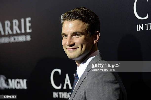 Actor Alex Russell arrives at the premiere of MetroGoldwynMayer Pictures Screen Gems' Carrie at ArcLight Cinemas on October 7 2013 in Hollywood...