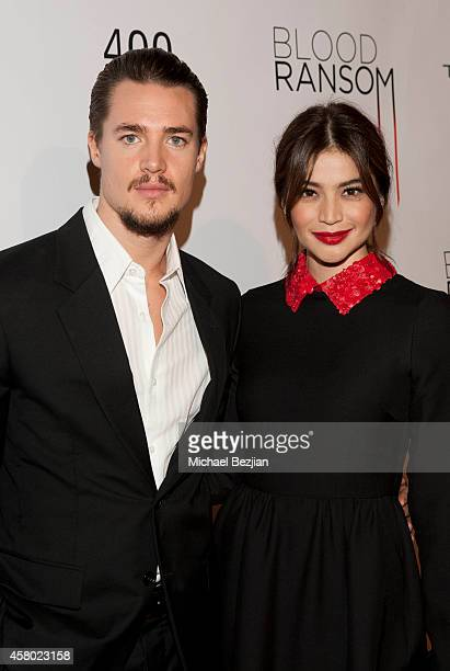 Actor Alexander Dreymon and actress Anne Curtis attend the Los Angeles Premiere Of 'Blood Ransom' on October 28 2014 in Los Angeles California