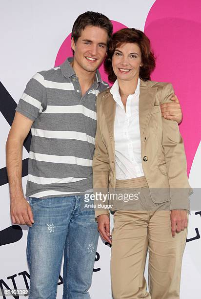 Actor Alexander Klaws and actress Karin Kienzer attend a photocall to the new German television SAT1 telenovela 'Anna und die Liebe' on August 18...