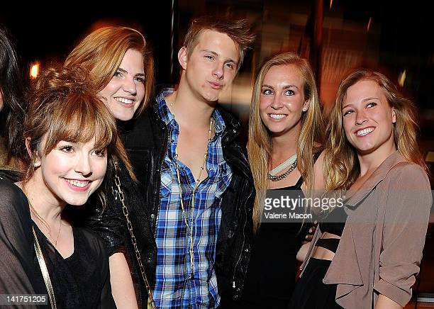 Actor Alexander Ludwig and fans arrive at the Opening Night Of Lionsgate's 'The Hunger Games' at the Regal Cinemas LA LIVE Stadium on March 22 2012...